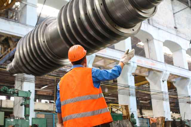 man standing near gray metal equipment